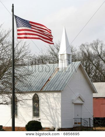 American Flag In Front Of An Old Church