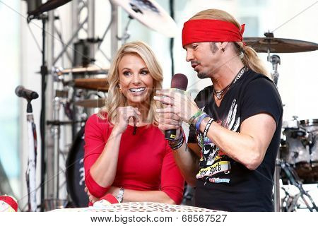 NEW YORK-JUL 18: Singer Bret Michaels (R) and Elisabeth Hasselbeck at Fox and Friends' All-American Summer Concert Series on the corner of 48th Street and 6th Avenue on July 18, 2014 in New York City.