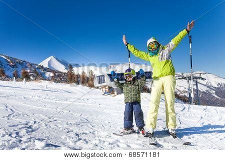 Mother and kid in masks standing with arms up