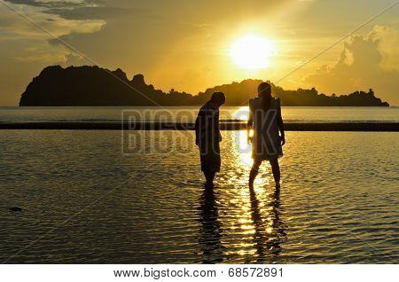 Girls And Boy On The Hat Sai Ri Beach During Sunrise