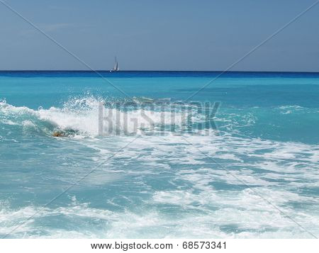 sea waves and sailing boat in the background