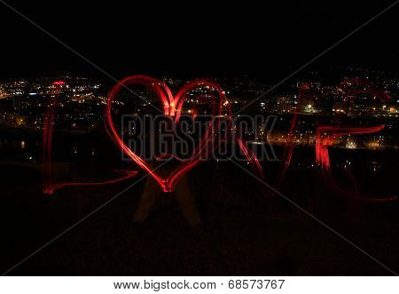Night city and love - blur photo of red lamps