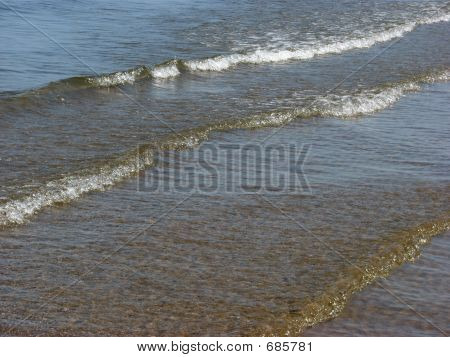 Waves Lap Gently On Shore