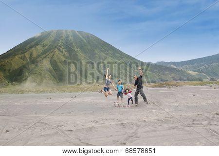 Happy Family Jump On Volcanic Desert 1