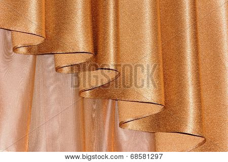 Open lambrequin (portiere, curtain) golden color on the window.