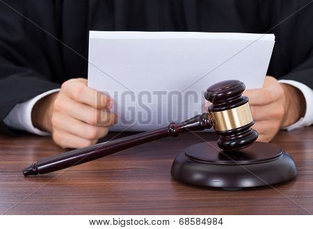 Judge Reading Documents At Desk