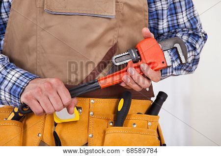 Repairman Holding Pipe Wrench
