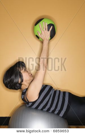 Woman Exercising With Gym Balls