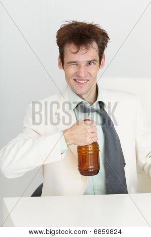 Cheerful Guy In A White Jacket With Bottle Of Beer