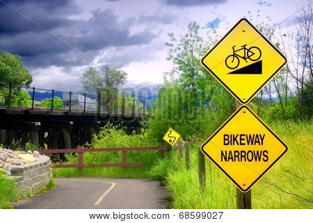 Bikeway narrows sign on bike path in Kalispell, Montana