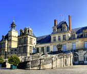 stock photo of chateau  - View of the Chateau de Fontainebleau and its famous stairway - JPG