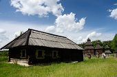 picture of farmworker  - Old wooden house with resurrection church from Poltavshina region - JPG