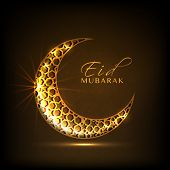 stock photo of ramazan mubarak  - Golden crescent moon on brown background for muslim community festival Eid Mubarak celebrations - JPG