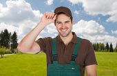 stock photo of dungarees  - Happy young gardener in dungarees - JPG