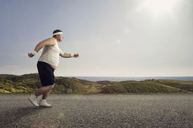 image of big belly  - Funny overweight man jogging on the road - JPG
