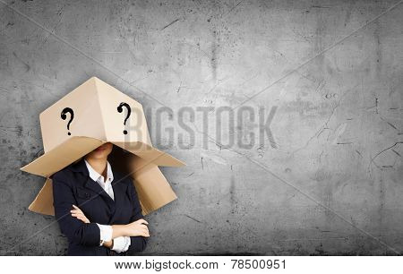 Unrecognizable businesswoman wearing carton box on head