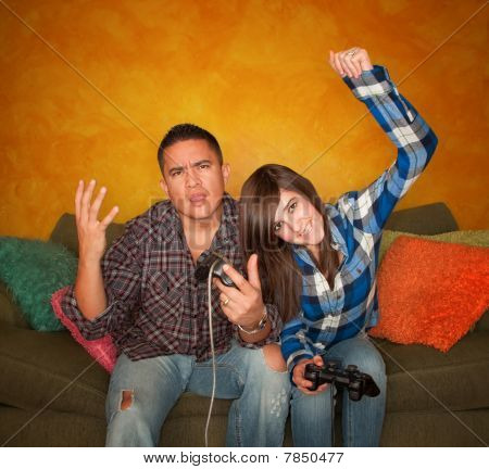 Hispanic Man and Girl Playing Video Game