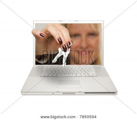 Woman Handing House Keys Through Laptop Screen