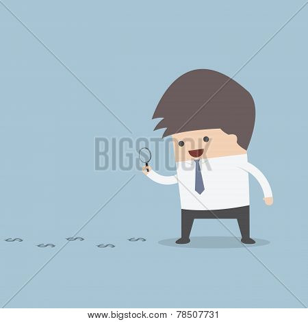Businessman Looking On Dollar Through Magnifying Glass