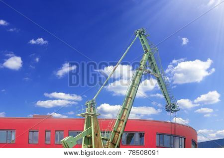 Old Harbor Crane In Front Of A Modern Day Office Building