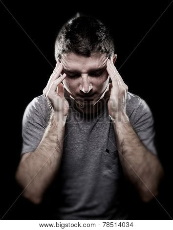Man Suffering Migraine Headache In Pain Feeling Sick With Hands On Tempo