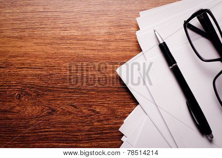 Pen, Paper And Glasses On Table With Copy Space