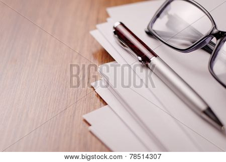 Conceptual Paper, Pen And Glasses On Table Top