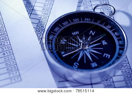 Compass Instrument On Top Of Paper Reports