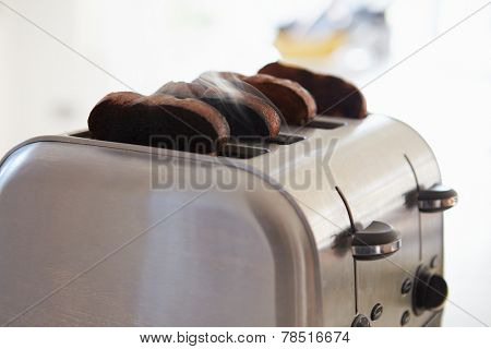 Close Up Of Burnt Toast In Toaster
