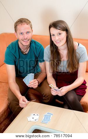 Young Couple Playing Card Game