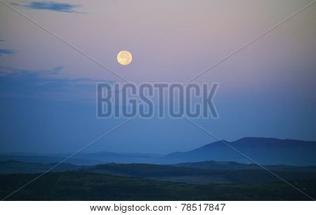 Moon over landscape with mountain