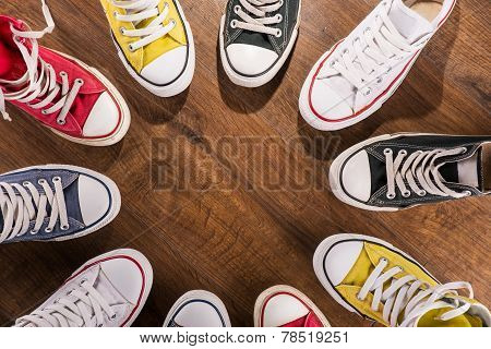 multicolored youth gym shoes on floor