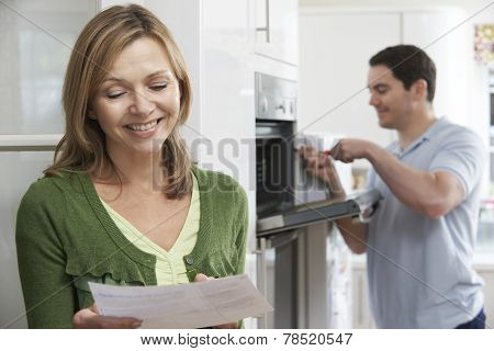 Satisfied Female Customer With Oven Repair Bill