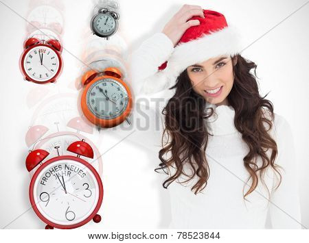 Confused brunette in santa hat against white background with vignette