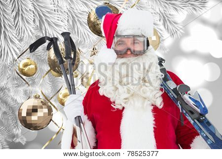 Happy santa posing with ski and ski poles against christmas decorations hanging from branch