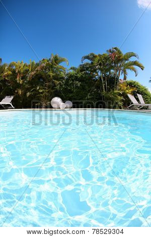 Closeup of private swimming-pool on sunny day