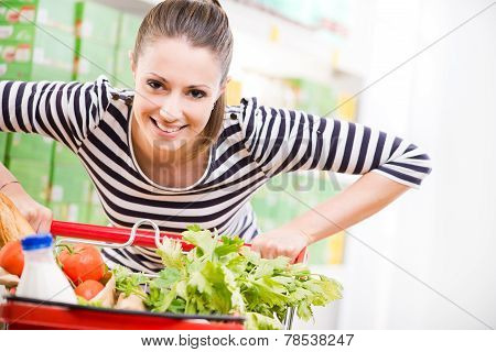 Woman Enjoying Shopping At Supermarket