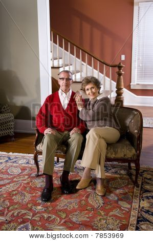 Senior Couple At Home In Living Room On Sofa