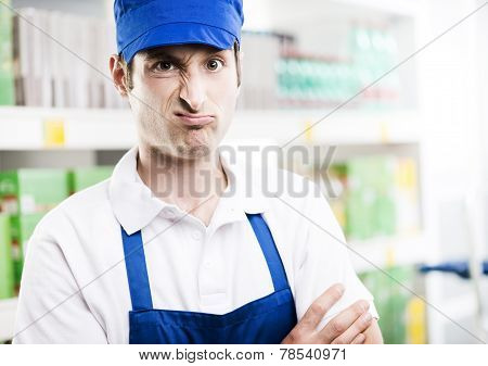 Sales Clerk Grimacing