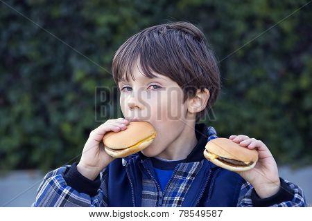 boy eating a hamburger