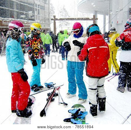Niseko, Japan -February 2013: Ski, Snowboard Playing With Colorful Jackets