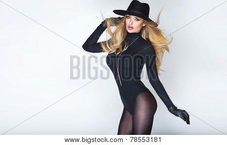 Elegant Blonde Woman In Hat