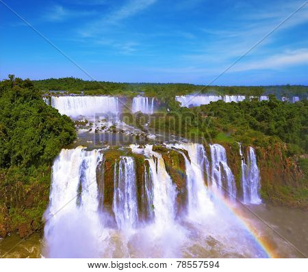 The most famous waterfalls in the world - Iguazu. Magnificent rainbow is above the thundering water jets. The Brazilian side of the falls