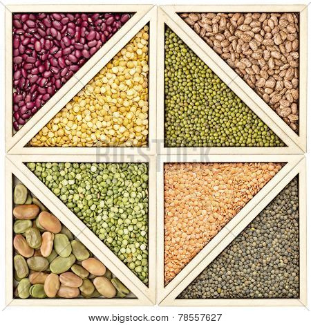 a variety of beans, pea and lentils in a wooden tray inspired by tangram puzzle