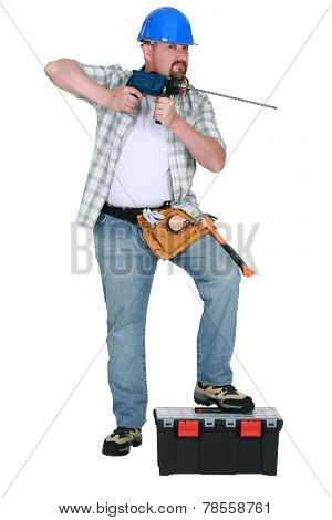 Tradesman holding a drill
