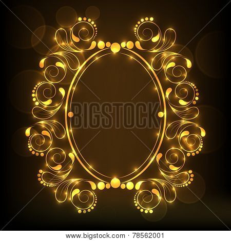 Beautiful frame decorated by shiny golden floral pattern in oval shape on brown background.