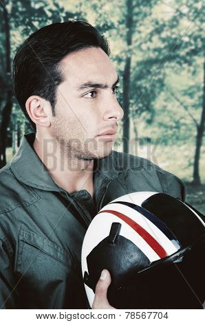 young handsome proud pilot wearing uniform and holding helmet