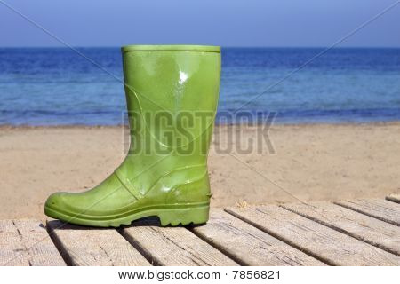 Green Boot On Beach Unlucky Fisherman Metaphor