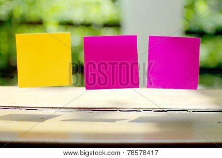 blank post it on clear glass panel