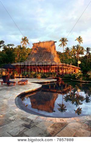 Pool and bar-hut in tropical resort.